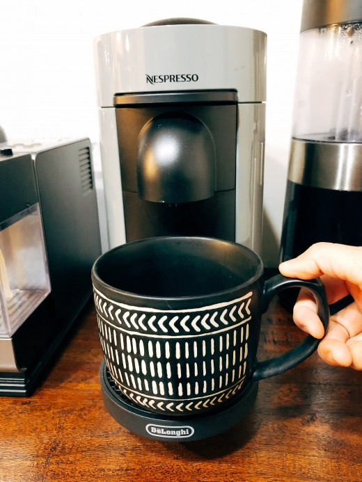 Place a cup or a mug of at least 27 fl oz. under the coffee outlet.