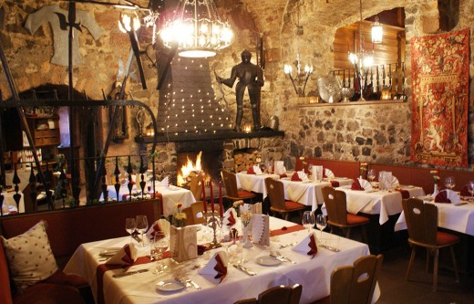 Castle hall dining with medieval hearth romance
