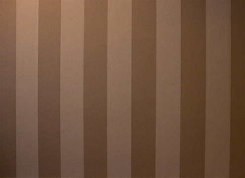 Get your painter's tape, yardstick and laser level to make perfectly, clean straight stripes.