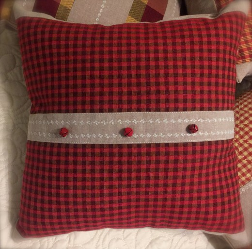 Bolder red fabric with bright red removable  jingle bells.