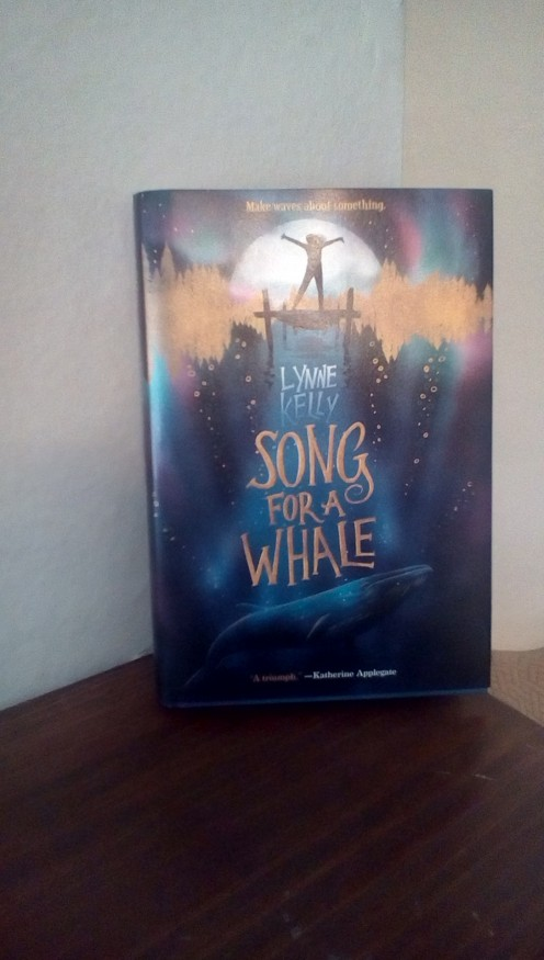 Delightful story of how a young girl uses her disability and technology to help a whale communicate with other whales.