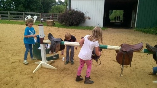 Clean tack or better yet, hold a kids day camp at the farm and let them clean it for you:-)