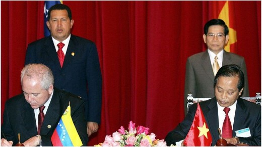 President Hugo Chavez and President Nguyen Minh Triet witnessed the signing of a petroleum cooperation agreement in Hanoi in 2006.