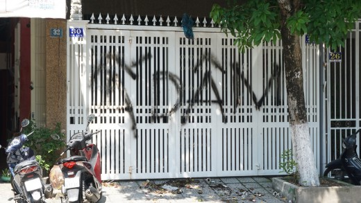 """The door of Mr. Nguyen Huu Linh's house in Da Nang is painted with the word """"Pedophile""""."""