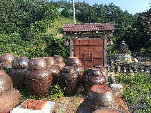 Traditional house with ginger- or kimchee jars.