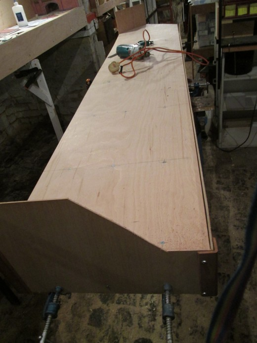 The view from the cellar stair end, the end panel cut to shape, attached middle and near end with back corner piece cut to size, awaiting back panel