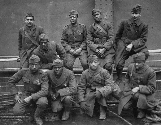 WWI: U.S. Army 369th Infantry Regiment won the Croix de Guerre from france for gallantry in action, 1919.  Men pictured are  Pvt. Ed Williams, Herbert Taylor, Pvt. Leon Fraitor, Pvt. Ralph Hawkins. Back Row: Sgt. H. D. Prinas, Sgt. Dan Strorms, Pvt.