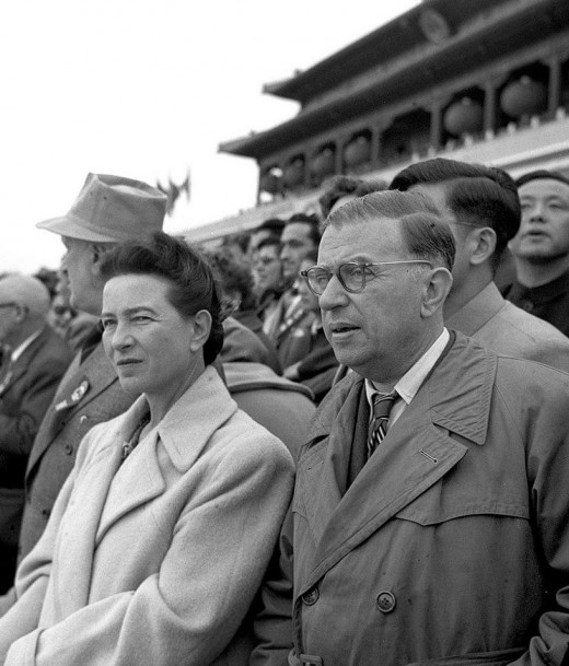 "Jean Paul Satre (right) with Simone de Beauvoir in 1955. Sartre provided a commonly used definition of existentialism which is that it is the belief that ""existence precedes essence."""