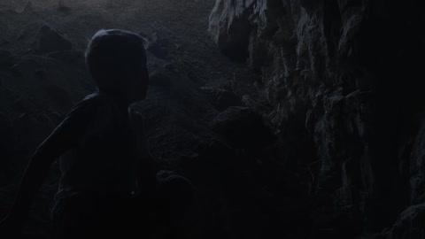 Boy walking through dark