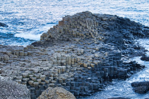 Igneous rocks can often create fascinating terrain, like these columnar basalt flows in Northern Ireland. The Giant's Causeway contains around 40,000 interlocking basalt columns, created by an ancient volcanic fissure eruption.