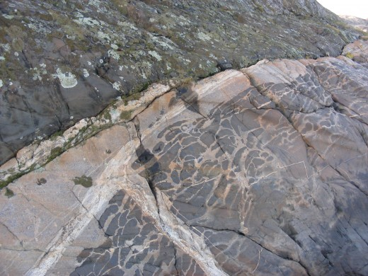 This rock from Kosterhavet, Sweden, shows how a mafic magma (dark material) and felsic magma (light material) can mix unevenly, creating banded patterns in the rock they form.