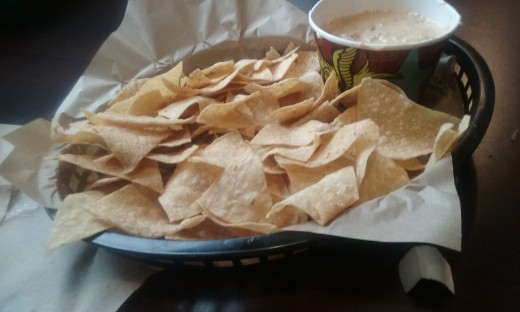 Comforting and filling hot queso cheese dip and nacho chips.