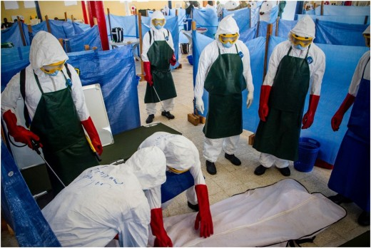 Health care workers learn how to properly dispose of the remains of a simulated patient who died from Ebola.