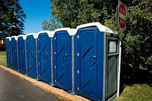 Drop down toilet