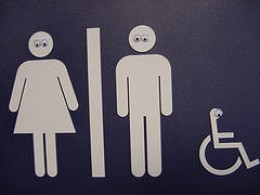 I like the googly eyes on this particular bathroom sign.