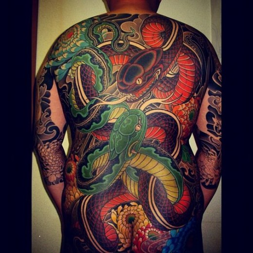 Double Japanese serpent tattoo by MIYAZO TATTOO