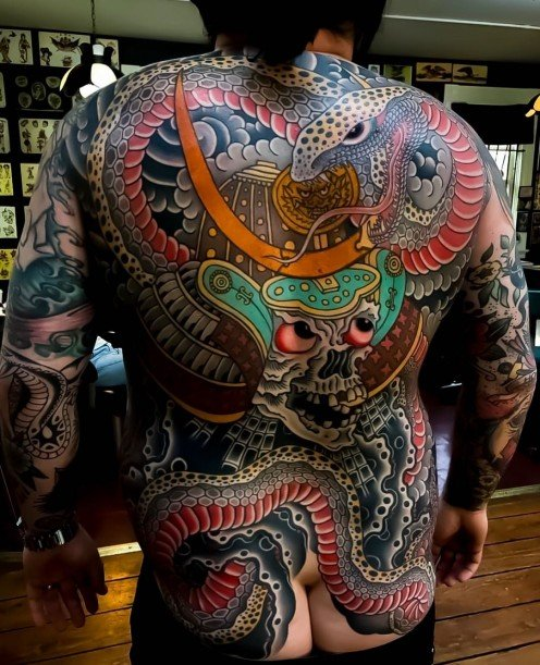 Traditional Japanese meets Americano snake tattoo with skeleton samurai by Greggletron