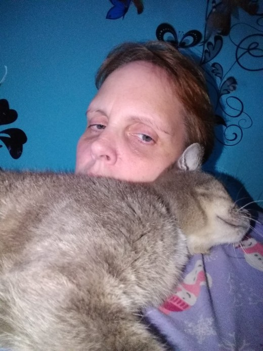 I call her my fur coat.  She loves to lay across my chest with her head in the crook of my neck.