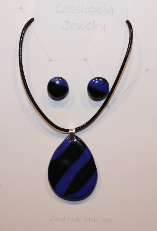 One of my first FIMO-clay jewellery works: a blue-and-black earring and pendant set.