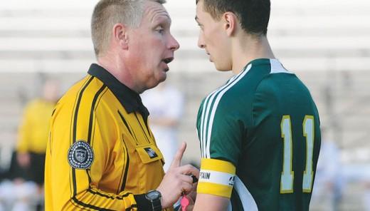 Referee warns a player