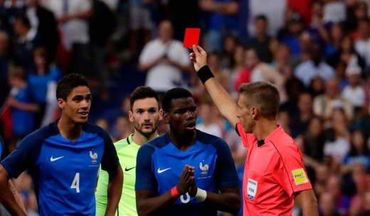Referee giving a player Red-Card