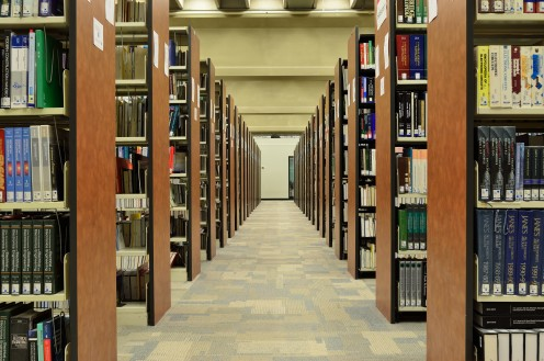 You can borrow college textbooks from your library.
