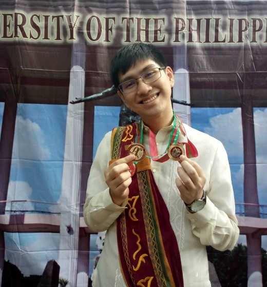 Joseph flashing a smile as he shows off his medals
