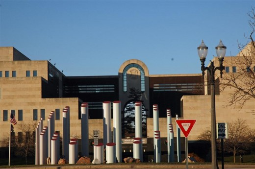 """Entrance to Michigan History Museum with Library of Michigan to left and Museum to right.  """"Stonehenge"""" sculpture is in the middle"""
