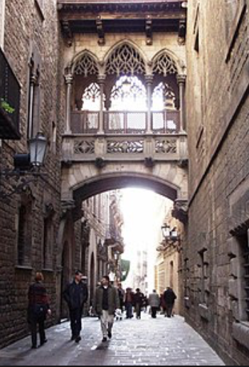 One of the many medieval styled streets in the Gothic Quarter, Barcelona.  Note the stones and arches, very characteristic of gothic architecture.