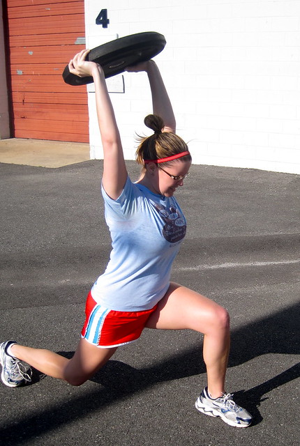 Walking weighted lunge works entire lower body and shoulders -- plus a bonus: works the core!