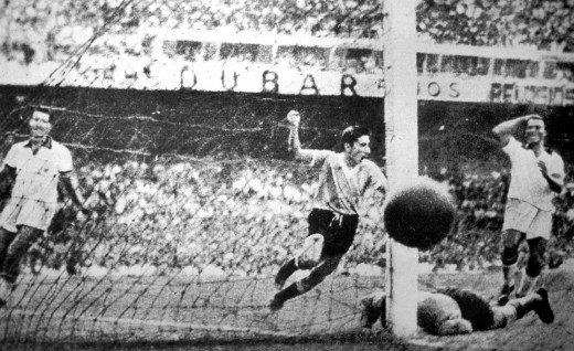 Alcides Ghiggia scores the winner against Brazil in the 1950 Final.