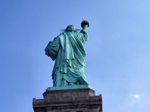 From behind you can see that Lady Liberty is walking forward!