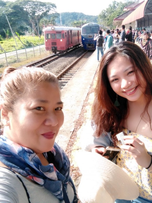 Me and daughter hopping on to see their century-old train here in KK