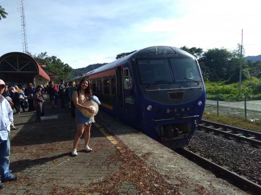 Striking a pose at Sabah's local train