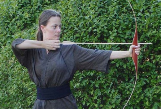 The tangible bow with action of pulling back to release and send the arrow flying through the air.