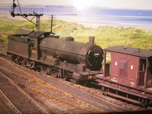 Q6 63429, latterly of North Blyth shed (52F) trundles along the coast back to her home depot with a fitted brake van. North Blyth closed to steam 9th September, 1967, about a week before steam traction ended in the North East of England