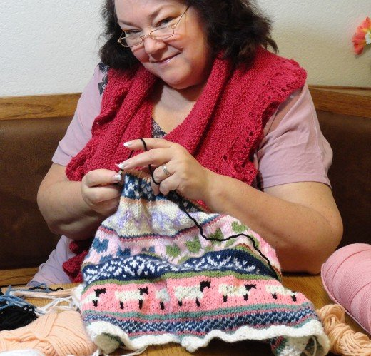 Me knitting a fair isle baby blanket for a grandchild.