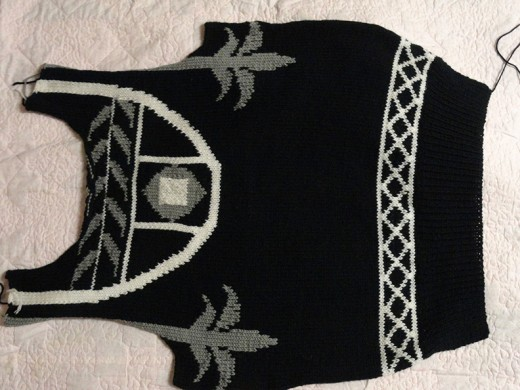 This knitted front of a sweater turned out too big because I didn't knit a gauge.