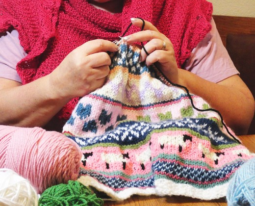 Happily Knitting a Fair Isle Baby Blanket for my grandchild.
