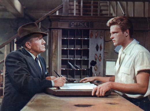 Spencer Tracy is finding that it's hard to get a room here