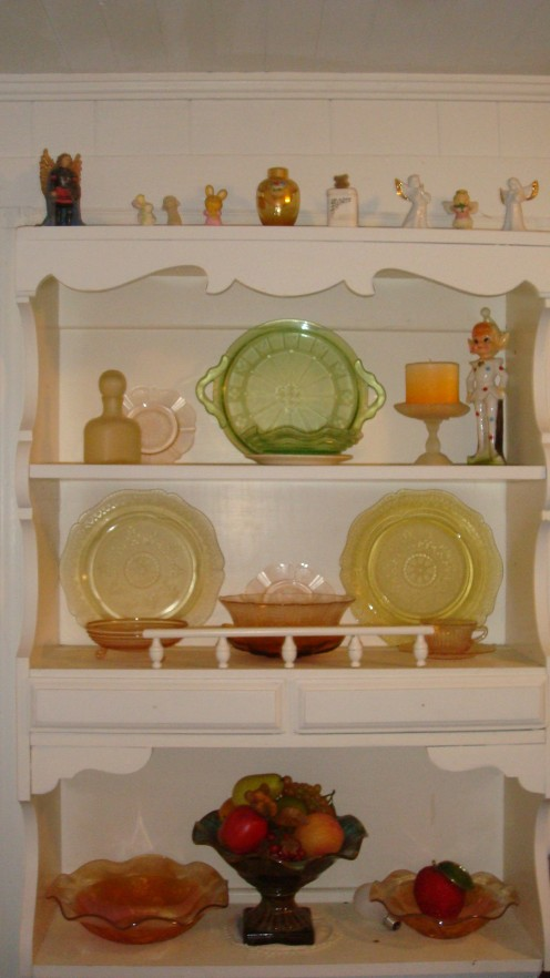 "This is my Depression Glass Collection. Not all the same pattern, but still has what I need! (The clown is the ""Watcher of Glass"" lol)"