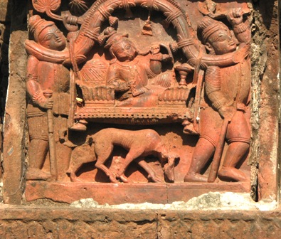 A social scene from the temple @ Kotalpur ,dt Hooghly.  A rich person being carried in a palanquin while he smokes a 'hookah'. Note the dog accompanying the palanquin.