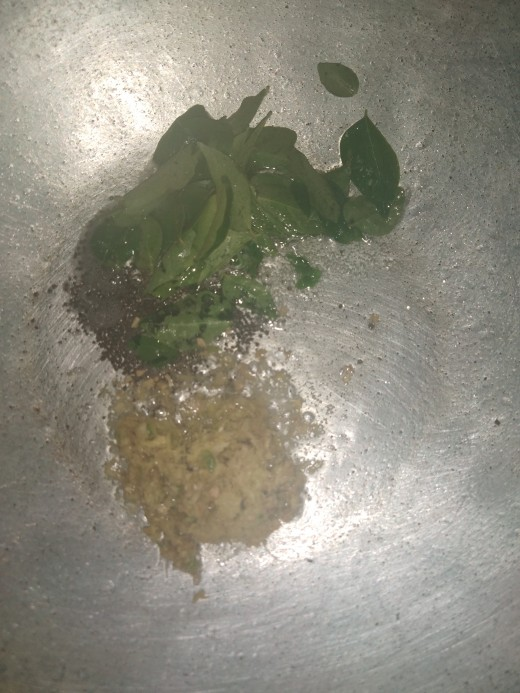 In a pan heat oil, splutter mustard seeds, add curry leaves and ginger-green chili paste, saute.