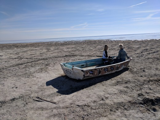My wife and daughter viewing Salton Sea from an abandoned boat on the beach.