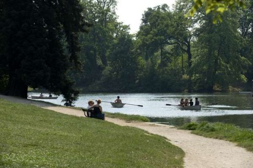 Boaters enjoying a leisurely day on the water in the Bois