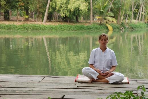 Man meditating by the lake