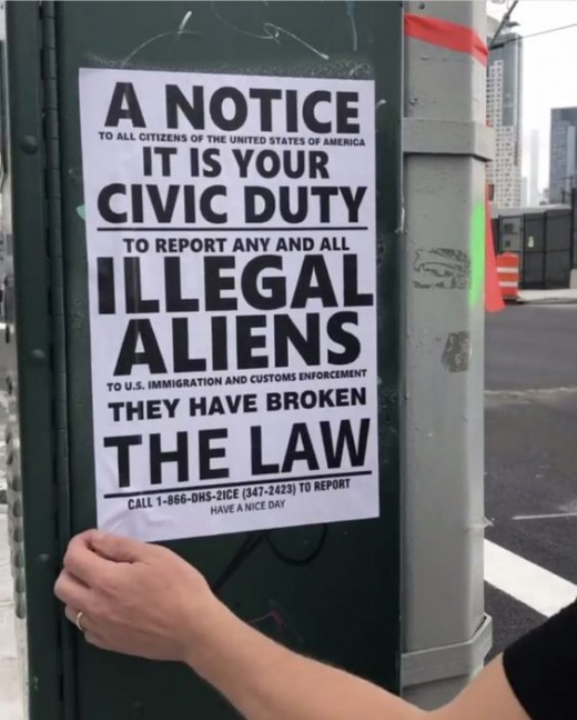 screenshot of video by Council Member Jimmy Van Bramer on Instagram, video showing Council Member ripping off sign asking citizens to report illegals