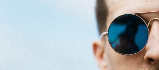 Man wearing polarized sunglasses.