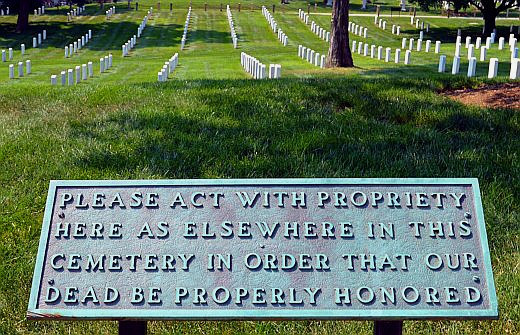 Signs encourage the quiet atmosphere of the cemetery despite the presence of thousands of tourists.