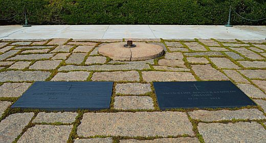 """The """"Eternal Flame"""" watches over the graves of John F. Kennedy and his wife, Jacqueline Kennedy Onasis."""